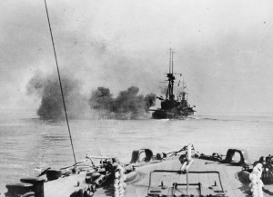 Bombardment and Landings: A French battleship firing at Turkish shore positions in the preliminary bombardment. © IWM (Q 53526)